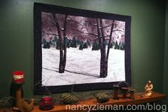 Here's a tutorial on how to design a landscape quilt, featuring a winter scene.