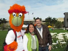@MiamiHEAT mascot posing with Gift of Life donor, Jill, and recipient, Scott.