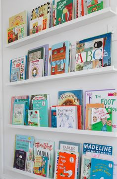 Living With Kids: Elle Rowley / I want to do shelves like this at the end of the hallway.