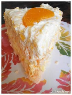 Coconut Orange Cake....This cake tastes as good at it looks. A moist orange and coconut cake is frosted with even more orange and coconut. It is divine. This would be a perfect dessert for Easter!!