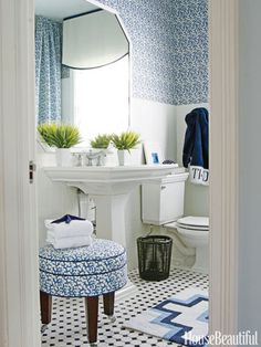 Designer T. Keller Donovan's fond of blue (as you can see), and he used several shades to bring it all together. Don't be afraid to mix it up! The rug on the floor has a different pattern than the wallpaper and stool, but it still feels organic to the room due to its colors.