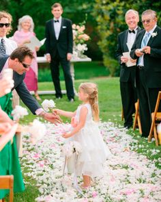 An alternative to tossing flowers is having your flower girls hand out flowers!