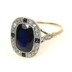 David Clay Jewelers - tried it on today... So beautiful.  The blue sapphire is nearly black!!!