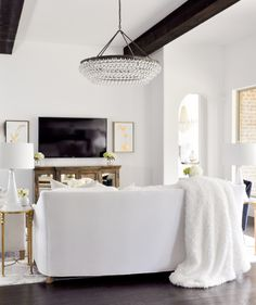 Living Room with beautiful chandelier and beams