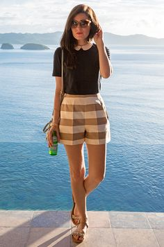 Shirt and sandals by J.Crew, shorts by Tibi, bag by Tory Burch. (November 25, 2014)