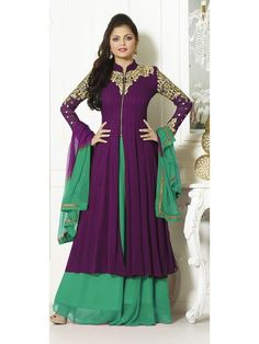 Get it in an exquisite shape so you are confident it will no way go outmoded. Wear this dark purple plazo suit in a combination of green and stay put your heavy curves covered.