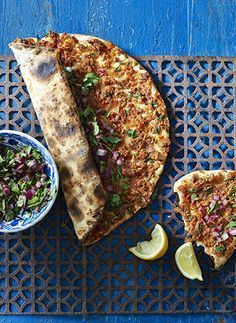 This tasty Turkish style pizza is made with a crispy base and a spicy meat topping. The Turkish lahmacun recipe is served with onions and sumac. Macrobiotic Diet, Turkish Fashion, Spicy, Sandwiches, Pizza, Tasty, Meat, Cooking, Recipes