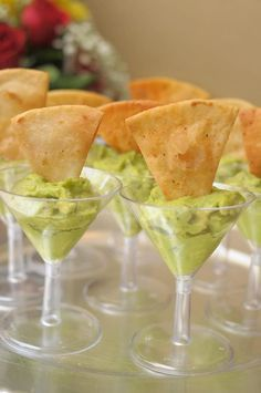 We love these miniature Martini glasses filled with guacamole and chips! A great passed hors d'oeuvre for cocktail hour with virtually no mess or fuss. I also serve mini prawn cocktails, Appetizer Dishes, Easy Appetizer Recipes, Yummy Appetizers, Appetizers For Party, Dinner Parties, Cocktail Parties, Tailgate Appetizers, Individual Appetizers, Elegant Appetizers