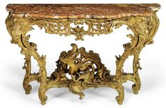 AN EARLY LOUIS XV GILTWOOD CONSOLE TABLE -  CIRCA 1725