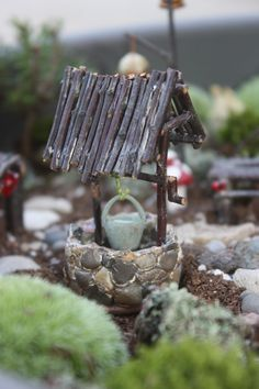 Make a Faerie Well with hot glue, stones and twigs