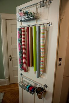 Wrapping center with cafe curtain clips to secure wrapping paper rolls