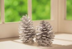 Set decorated pine cones in candlesticks to hold them in an upright tree position.