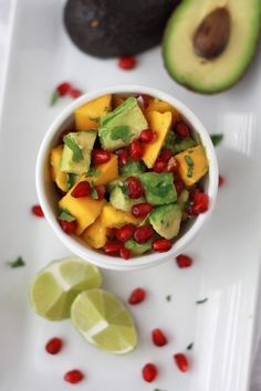 Pomegranate Mango Salsa ~ Oh man this is SO good! Pomegranate, creamy avocado and the sweet mango. Cilantro, salt, and a bit of lime juice really bring everything together