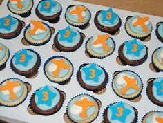 orange and blue 3rd birthday birthday cupcakes by Simply Sweets, via Flickr