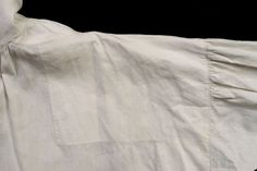 Although very little of the man's shirt would show, it is a wonder of fine workmanship. Shirts were the man's basic undergarment and would have protected the outergarments from the body's oils. Whi…