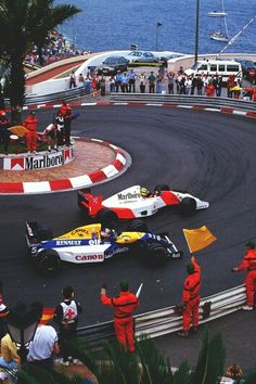 Senna and Mansell - Monaco - Classic hard fought race, where the Williams was so much faster, but Senna's skill prevailed