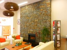 The inside of a bank is transformed by using our Colonial Schist veneer.