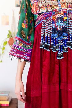 Pashtun Dress Beautiful Afghani dress made from vintage and new fabrics with heavy bodice of coins, beads and embroidery. This unique dress is a work of art and can be either worn or used as a decorative item. Mat- Rayon+ cotton