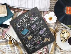 Settle down & snuggle up! We have the ultimate list of cozy essentials on the blog - inspired by our print! Take a look. (Link in profile.) . #lilyandvalliving #lilyandval #cozyessentials #chalkboardart #chalkart #hyggeliving #snuggleup #typography #handdrawn http://bit.ly/2kjE327
