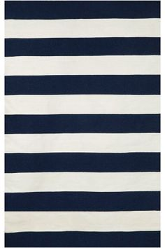 Synthetic outdoor rugs make it easy to spruce up your space with color and pattern! Try a bold stripe look this year.