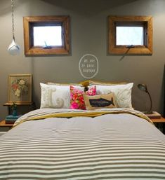 LOVE this! Would be cool to put two mirrors, and love the little quote with some bright pillows!
