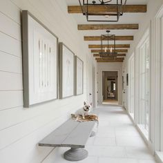 Entryway Design Ideas modern farmhouse entryway or hallway with wood beams and floor to ceiling wind Farmhouse Design, Modern Farmhouse, Farmhouse Decor, Farmhouse Ideas, Farmhouse Stairs, Farmhouse Interior, Farmhouse Style, Entryway Lighting, Entryway Decor
