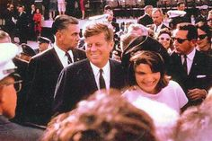 President and Mrs. Kennedy on Thursday, 11/21/63, the day before the assassination.    Clint Hill is to the right.