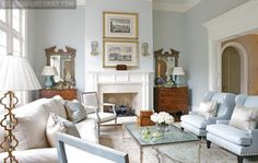 love light blue and white decor chests and mirrors flanking fireplace. Double stack pictures over fireplace