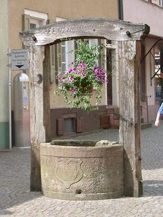 Gengenbach, an old medieval village (German town in the middle of the Black Forest) and an old wishing well in wood/stone