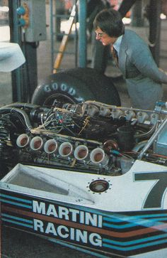 Bernie checking over the Brabham in the garage. I believe that this is when he owned the Brabham Racing Team.