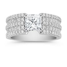 Princess Cut and Round Diamond Engagement Ring with Princess Cut Diamond. This stylish and distinctive setting combines two dazzling diamond shapes. Thirty-two princess cut diamonds, at approximately .85 carat TW, and sixty round diamonds, at approximately .52 carat TW are set in a exquisite 14 karat white gold setting. This elegant design awaits the center diamond of your choice. The total diamond weight is approximately 1.37 carats. #ShaneCoLBD