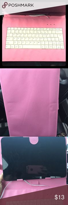 """Pink tablet case with key board. It's pink with a keyboard. Off brand. Holds up to a 7""""- 10""""  Yes, you might need to change the settings around in your tablet. You might need to buy a mini usb adaptor. I'm horrible with the tablet stuff. You can't just plug it in and it will work.  It is compatible with a Windows or android tablet. It doesn't work with my Verizon tablet. And that's why i'm practically giving it away. Purchase at your own risk. I haven't been able to see the keyboard work…"""