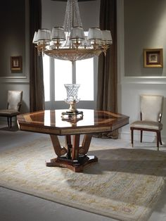 Octogonal table, suitable for an entry hall or a dining room, from our Park Lane Collection. Made in Cerejeida and Oak wood, with French gold casted bronze ornaments, Mariner Luxury Furniture