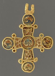 ca. 1100 from Constantinople.    This elegant pendant cross with four equal arms radiating from a central medallion is representative of the finest objects for personal devotion produced for the elite of the Byzantine Empire. Both faces of the exquisite miniature cross are decorated with intricate floral patterns worked in multicolored cloisonné enamel.    At the Metropolitan Museum of Art.