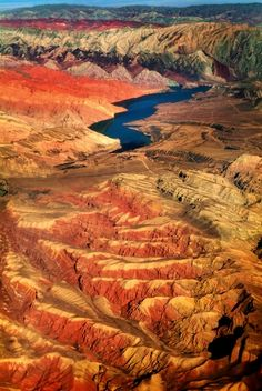 Badab-e Surt, Iran  created by sedimentary rock and water flowing from two unique mineral springs