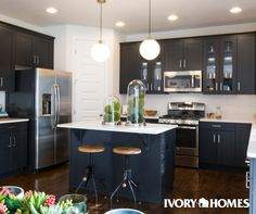 Contemporary Navy Kitchen! How great is the combo of the dark floors with the navy and white?