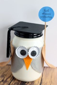 """""""Make this graduation mason jar gift for anyone that is graduating! This fun owl mason jar is easy to make and a great gift idea. Fill the jar with the gift of your choice. You will have an adorable graduation mason jar gift in no time at all. College Graduation Gifts, Grad Gifts, Diy Gifts, Graduation Parties, Graduation Decorations, Graduation Ideas, Mason Jar Projects, Diy Projects, Mason Jar Gifts"""