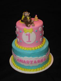 Curious George themed cake for a little girl's 1st birthday.  George was hand crafted from fondant.