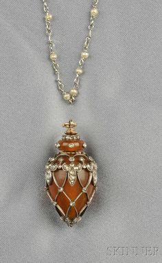 Antique Amber Pendant and Chain, the amber urn with silver and rose-cut diamond mount, lg. 1 1/2, together with an associated platinum and pearl longchain, lg. 49 in.