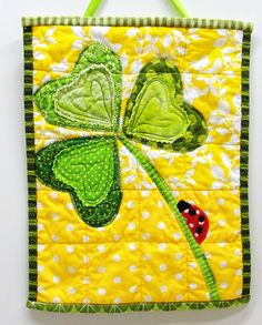 St Patrick's Day wall quilt with shamrock and ladybug
