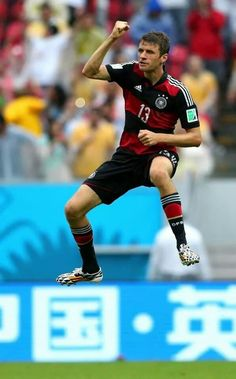 Thomas Muller celebrating after scoring goal when they play with Brazil.