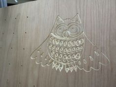 Cnc engraved owl on cherry plywood. The holes will have dowels installed for sewing thread storage.
