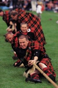 tug o' war at a Highland Games (probably not in Scotland though, where they have more sense than to wear full attire!)