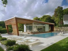 """Pool House"": Designed by the Hariri Sisters (an Architectural Digest 2012 AD100 winner), this 1200 SF pool house is clad in Ipd wood (Brazilian walnut), imbuing the space with warmth and a nautical feel; Wilton, Connecticut 