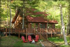 Cool cabin in the woods. Love the wrap around porch!