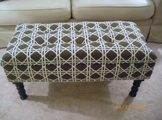 Make an upholstered ottoman out of a console table or nightstand.