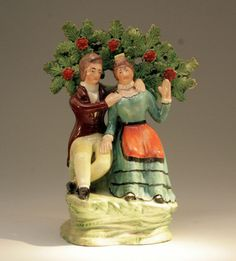 ANTIQUE STAFFORDSHIRE POTTERY PEARLWARE FIGURE COURTSHIP another disturbing one is he gonna hug her or chokel her? she looks like shes gonna haul off and slap him either way