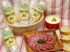 This Rich, flavorful French Saucisson Sec has an excellent balance of seasoning and flavor. The pork meat is blended with fresh garlic, sea salt and black peppercorn in an all natural beef casing, cured 30 days and hand tied. [ www.enjoyfoiegras.com ]