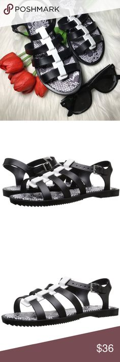 """Black and White Jelly Gladiator Sandals Ladies flat gladiator jelly sandal. Heel measures approximately 0.5"""" Platform measures approximately 0.25 inches Multiple strap jelly sandal. Call it Spring *Note: While this brand is owned by Call it Spring and sold at ASOS, some Of these pieces can be purchased at other retailers. ASOS Shoes Sandals"""