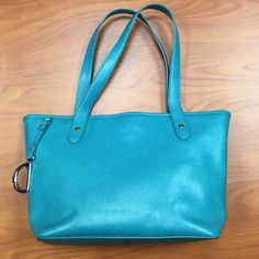 Ralph Lauren Newbury Tall Shopper purse Like new, turquoise colored Ralph Lauren purse. In great condition- used one or two times. Textured exterior leather and brown canvas interior lining. Spacious bucket- shaped, inside featuring interior zipper pocket & 3 different slip storage interior pockets. Tote handles allow for carry via shoulder. Measurements: 10in high, 15in long, 7 inches wide Ralph Lauren Bags Shoulder Bags